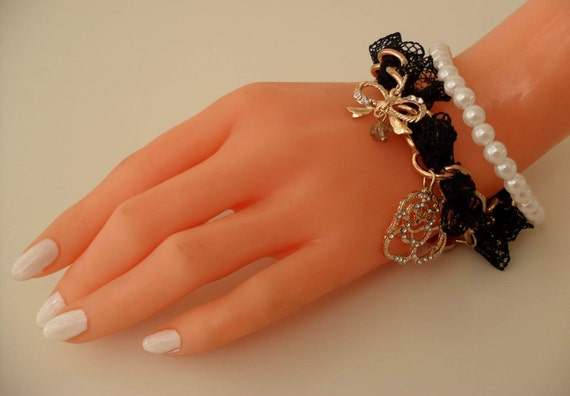 Black Bracelet with Goldplated Items and Pearl Beads