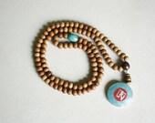 Sandalwood Meditation Mala with Coral & Turquoise Om Pendant