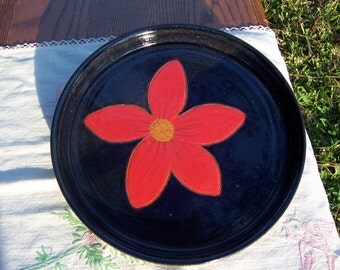 Stoneware pie plate glazed in deep blue with bright red handcarved  flower.