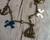 FREE SHIPPING. Sail Away. Sail boat, Anchor, and Globe Nautical Inspired Pirate Charm Bracelet. Antique BronzeBrass.