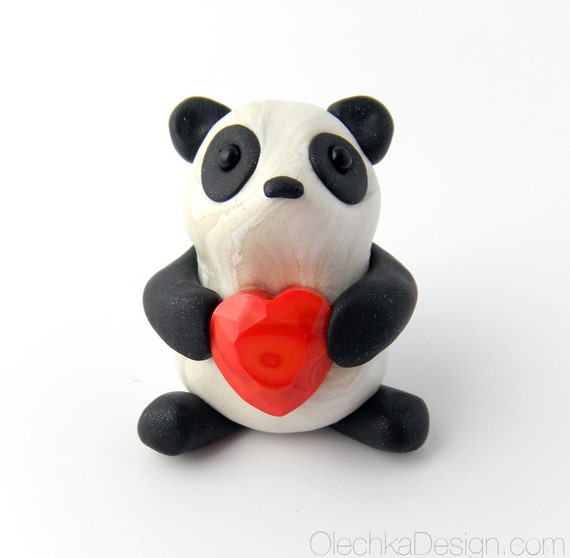 Cute Panda holding a Heart Sculpture made of Polymer Clay