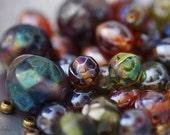 Destash - 30 irregular iridescent lampwork glass beads and 16 metal spacers