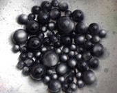 Over 60 vintage silver-charcoal grey beads in graduating sizes from the Bellwether Beadery