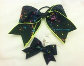 """3"""", 3 inch cheer cheerleader bow and matching key chain with a splatter paint design"""