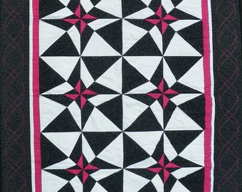 Black, white, and fuchsia geometric quilt for wall hanging, small lap or even modern baby quilt.