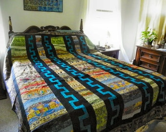 Along the Nile queen comforter with Egyptian motifs.