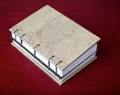 Hardcover Coptic-bound dos-a-dos with opalescent snakeskin-textured paper