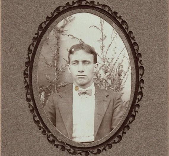 C.1910 Antique unusual man portrait. Oval framed.