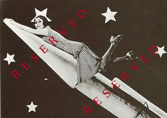 RESERVED. Woman on a rocket in the sky, with moon and stars. Vintage postcard
