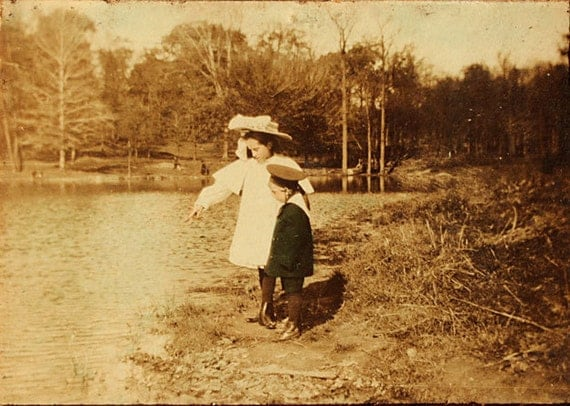 C. 1910 Children on the bank of Lake. Colored photo on card