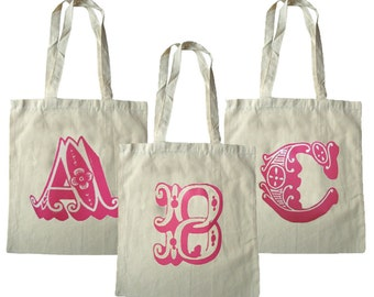 Personlized cotton tote bags with alphabet letter and long handles.