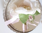 Moms corsage of vintage leaf brooch surrounded by handmade fabric flower