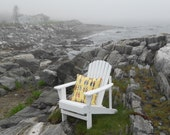 Photo of Adirondack Chair on rocky coast of NH