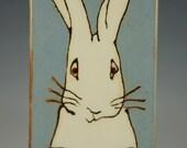 Curious Rabbit with a vintage feel on a handmade ceramic tile