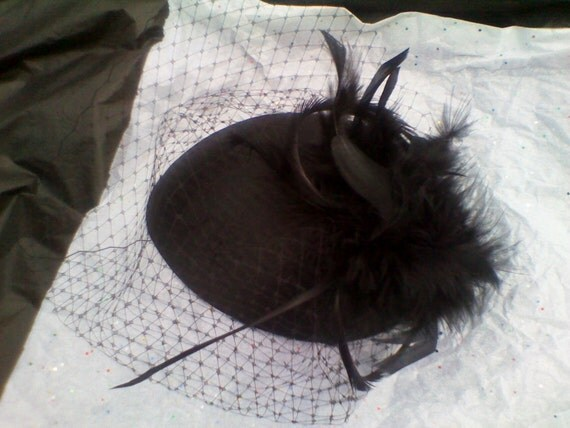 Black Vintage Inspired teardrop shaped fascinator with birdcage veiling and black goose biot and boas feathers.
