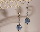 Shiny blue dangly earrings