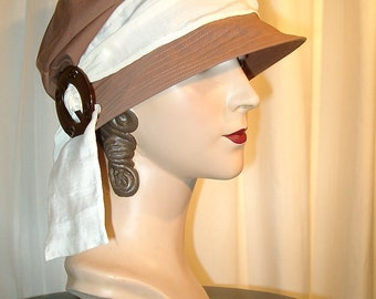 Cloche of cotton in warm brown with beautiful antique buckle