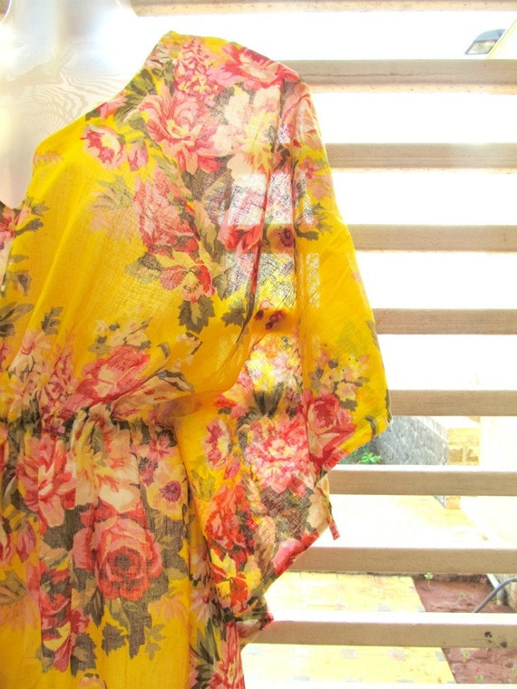 Yellow cotton kaftan with bouquets of pink and red flowers - just in time for spring and summer