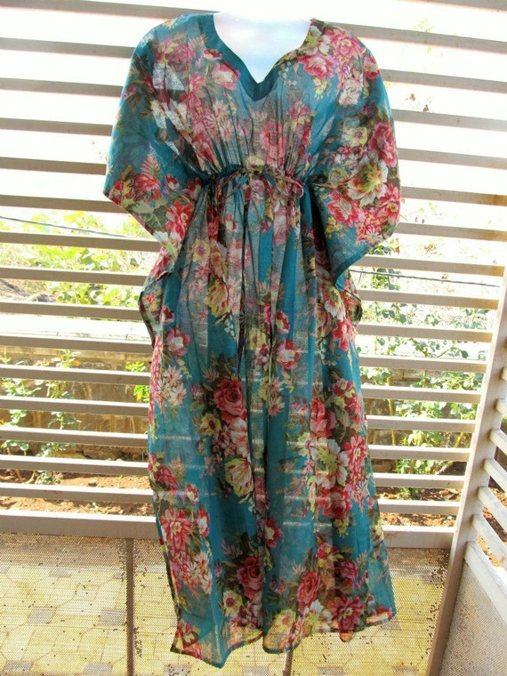 Light blue cotton kaftan with bouquets of pink, yellow and red flowers