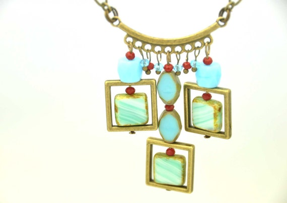 A unique necklace made with Turquoise blue Czech Picasso glass beads,square, table cut and small red and light blue crystals