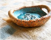 Turquoise blue Ceramic Platter, coral decorative pattern and decorative handles wrapped with rattan.