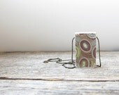 "Rustic, woodland urchin style print wood pendant 1'"" x 1.5"", on 8"" chain. Reversible, hand finished, brown, cream, lime."