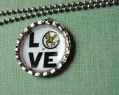 Hunger games bottlecap necklace