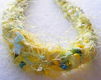Fiber Necklace yellow ribbon and fizz, beaded.