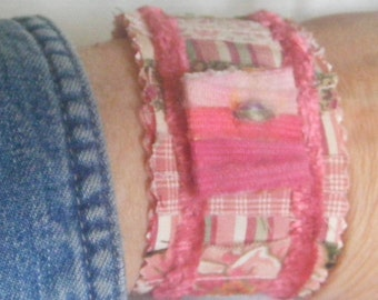 Slap Cuff Bracelet Pinky Pooh with a square textile button