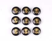Vintage black gold plastic buttons. Set of nine.