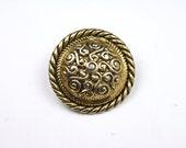 Vintage antique gold metal button with spirals.