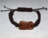 Bracelet with coconut shell.