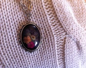 purple antiqued plated brass pendant with real pressed flowers and a glass cabochon on a 52cm chain
