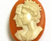 Royal Celluloid Cameo Brooch featuring HRH Queen Elizabeth and The Duke of Edinburgh.