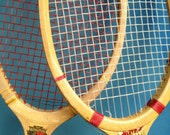 Two wood tennis rackets from a long time ago.