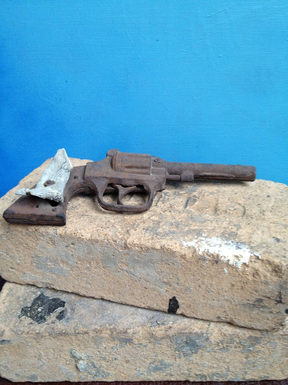 ON HOLD ...Old rusty metal toy pistol