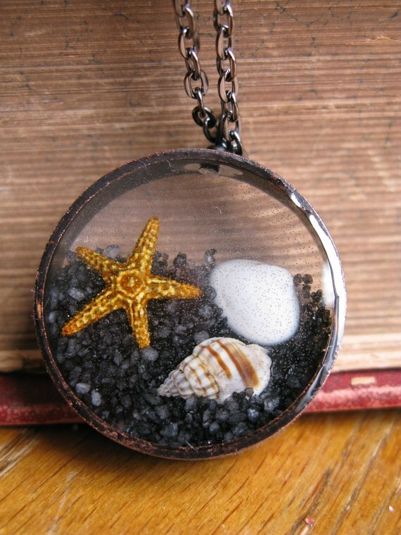 At the Beach Pendant - Sand, shells, and starfish encased in resin with black open back bezel