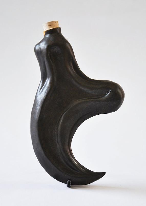 Porcelain Velociraptor Claw Flask