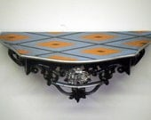 Ornate Shelf with Blue and Orange Argyle Top