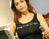 Stay True To You done in vintage looking silk screen on a black workout tank top with a plain back