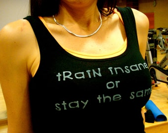 Train Insane or Stay the Same done in vintage looking silk screen on a black workout tank top with a triple sliced back