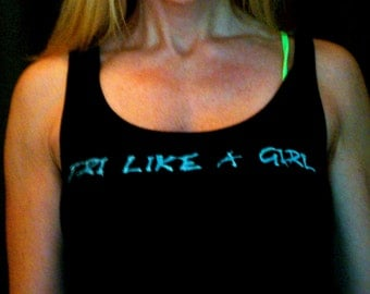 Tri like a Girl triathlon done in vintage looking silk screen on a black workout tank top with a plain back