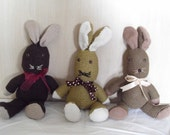 Hand knitted bunnies - needing lots of hugs and the occasional carrot.........