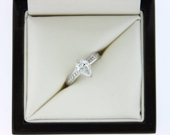 1.50ctw Pear Diamond Engagement Ring with Princess Side Stones