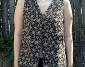 Floral one button vest size Medium