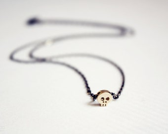 tiny skull necklace - gold skull on black chain - dainty jewelry / gift for her under 20