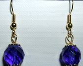 Dark blue 10mm czech fire polished beads on 22kt gold plated earwires.