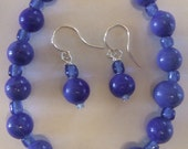 Dark royal blue glass bead bracelet and earring set. Silver plated ear wires.