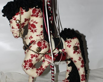 Rosie the  Carousel Horse, accented with ribbon and rhinestones.