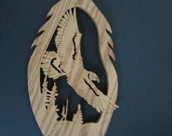 Eagle flying over trees inside of a feather